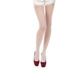 Pés fêmeas bonitos nas meias Imagens de Stock Royalty Free