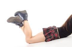 Pés fêmeas despidos nas botas Fotografia de Stock Royalty Free