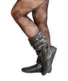 Pés fêmeas no pantyhose e nas sapatas Fotografia de Stock Royalty Free