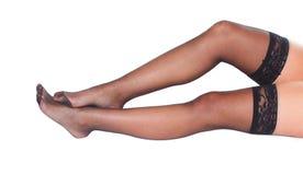 Pés fêmeas 'sexy' com meias imagem de stock royalty free