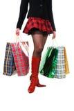 Pés fêmeas 'sexy' com sacos de compra Imagem de Stock