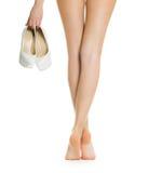 Pés e sapatas longos da mulher Imagem de Stock