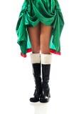 Pés magros da mulher que vestem a roupa do duende Fotografia de Stock