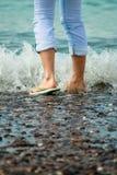 Pés na água Foto de Stock Royalty Free