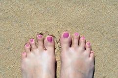 Pés na areia Foto de Stock