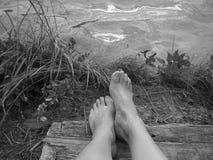 Pés na costa Fotografia de Stock