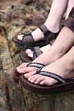 Pés nas sandálias Imagens de Stock Royalty Free