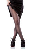 Pés 'sexy' e sapatas da mulher isolados no branco Foto de Stock