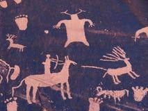 Pétroglyphe de chasse Images stock