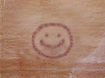 Pétroglyphe de visage souriant Image libre de droits