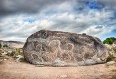 Pétroglyphe sur la pierre Photo libre de droits