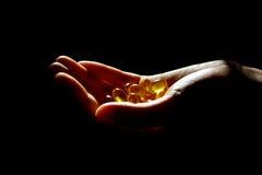 Pétrole de foie de morue Omega 3 capsules de gel Photographie stock libre de droits