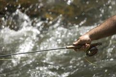 Pêche à la ligne sur le fleuve photographie stock