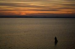 Pêche au coucher du soleil Photos libres de droits