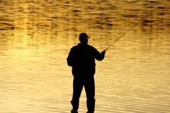 Pêche au coucher du soleil Images libres de droits