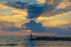 Pêche au coucher du soleil Image stock