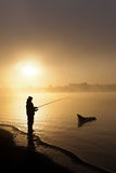 Pêche au lever de soleil Photo stock