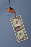 Pêche avec de l'argent photo stock
