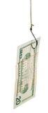 Pêche avec 20 dollars d'amorce de billet de banque sur l'hameçon Images stock