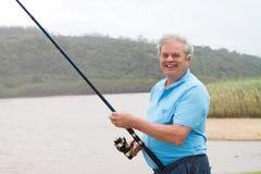 Pêche d'homme aîné Photo libre de droits