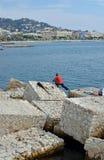 Pêche d'homme des roches à Cannes, France Image stock