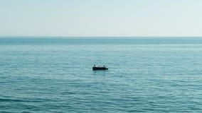 Pêche dans un petit bateau Photographie stock