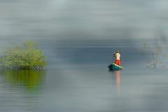 Pêche de canoë Images stock