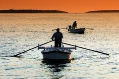 Pêche de coucher du soleil Image libre de droits
