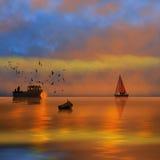 Pêche de coucher du soleil Photographie stock