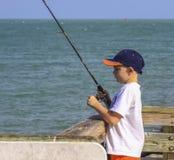 Pêche de garçon photo stock