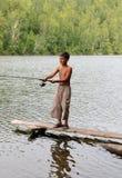 Pêche de garçon avec la rotation Image libre de droits