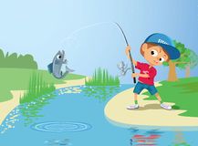 Pêche de garçon en rivière Photos stock