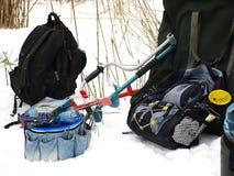 Pêche de l'hiver Cannes à pêche et accessoires Images libres de droits