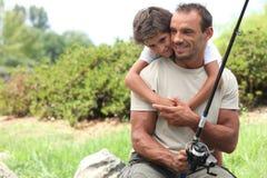 Pêche de père et de fils Photo stock