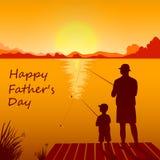 Pêche de papa et de fils sur le coucher du soleil ensemble Photo stock
