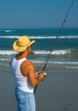 Pêche de vague déferlante Photographie stock libre de droits