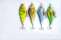 Pêche des attraits sur le blanc images stock