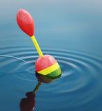 Pêche du flotteur dans l'eau Photographie stock