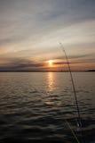 Pêche Pôles au coucher du soleil Images libres de droits