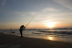 Pêche presse de la plage Photographie stock