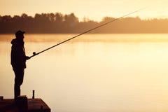 Pêche sur le lac de matin Photographie stock libre de droits