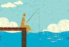 Pêche sur un dock Photographie stock libre de droits