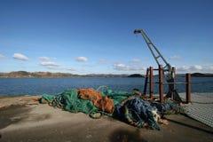 pêche sur un dock en Ecosse Photographie stock libre de droits