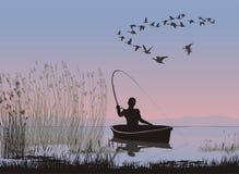 Pêcheur à la ligne sur un bateau Photo stock