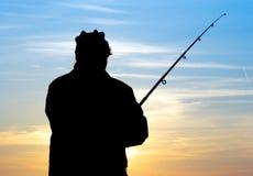 Pêcheur à la soirée Photo stock