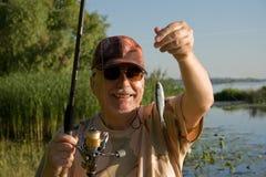 Pêcheur aîné heureux. Image libre de droits