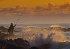 Pêcheur au lever de soleil Photos stock