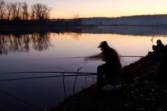 Pêcheur au lever de soleil Images stock