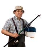 Pêcheur avec la canne à pêche et les attirails de pêche Photos libres de droits
