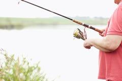 Pêcheur avec le plan rapproché de tige Photo libre de droits